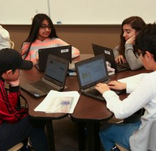 students gathered around computers